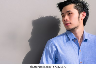 Portrait a handsome businessman: An attractive guy is looking to something and feeling relaxed when the summer season is coming with beautiful sunlight background