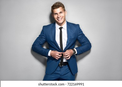 Portrait of handsome businessman in blue suite