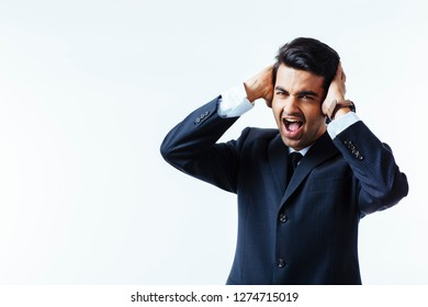 Portrait of a handsome businessman holding his head in disbelief, in pain or meditating,  isolated on white background, screaming