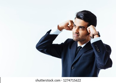 Portrait of a handsome businessman holding his head with both fists in disbelief, in pain or meditating,  isolated on white background