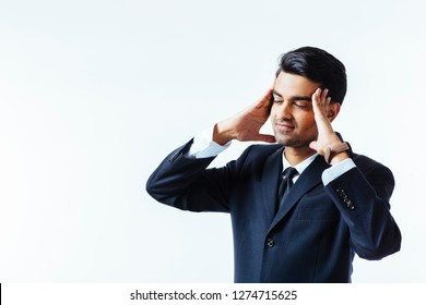 Portrait of a handsome businessman holding his head in disbelief, in pain or meditating,  isolated on white background