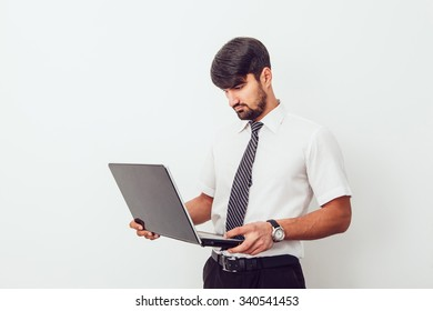 Portrait of an handsome businessman with a laptop