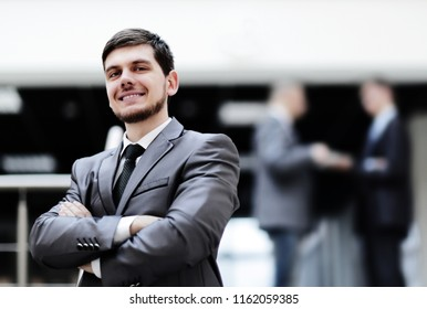 portrait of handsome businessman on blurred office background