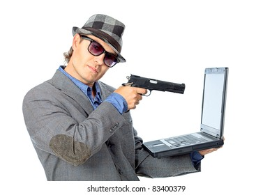 Portrait of a handsome businessman shooting to his laptop. Isolated over white background.
