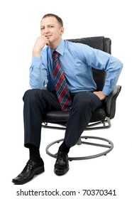 Portrait of a handsome businessman sitting in a armchair and  thinking, over white background