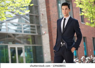 Portrait of a handsome businessman walking to work