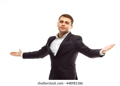 Portrait of handsome businessman wearing black suit spreads his arms to the sides isolated on white