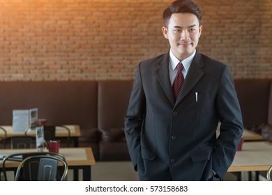 Portrait of handsome businessman wearing black suit