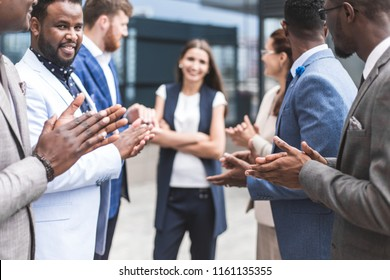 Portrait of an handsome businesswoman in front of his team. recognition, movement on the career ladder, success in business