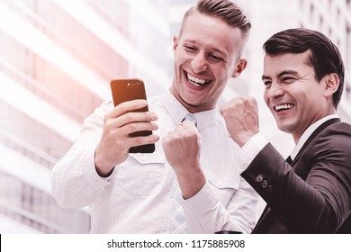 Portrait of handsome caucasian confident businessmen happy with smiling face  on city background. Succesful business concept.