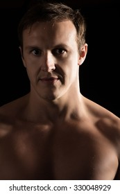 Portrait of a handsome caucasian male mixed martial arts fighter.