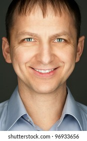 Portrait of handsome caucasian man looking at camera and smiling