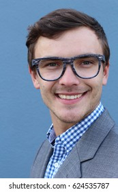 Portrait of handsome cheerful young smiling man in glasses