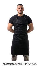 Portrait of handsome chef in black apron
