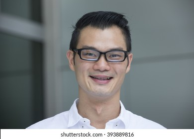 Portrait of a handsome Chinese man smiling and looking at the camera.