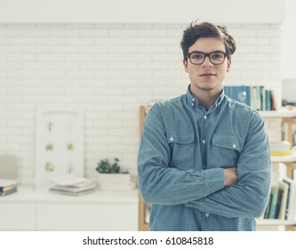 Portrait of handsome college student in classroom.