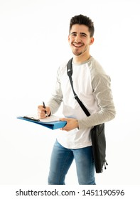 Portrait of Handsome college student man with backpack and notepad folder smiling against white background on his way to university lecture. in People fashion and university lifestyle concept.