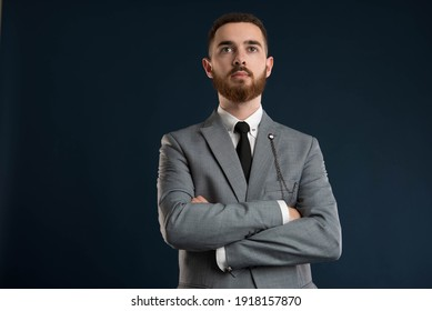 Portrait of a handsome confident businessman wearing a grey jacket and a black tie