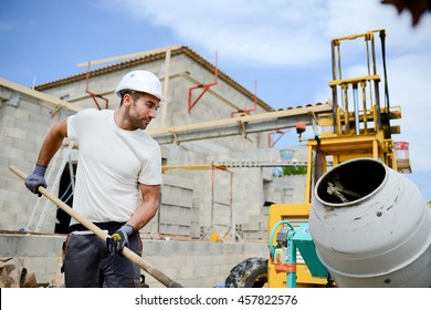 portrait of handsome construction worker on a building industry construction site