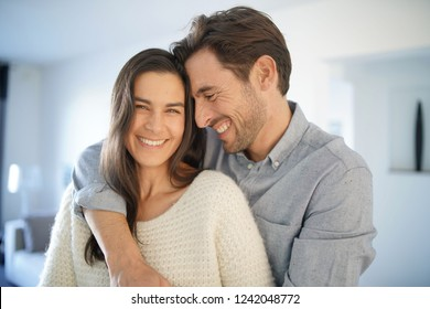 Portrait of handsome couple in modern house