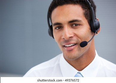 Portrait of a handsome customer service agent at work in a company