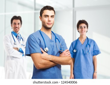 Portrait of an handsome doctor in front of his medical team