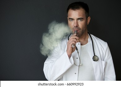 portrait of handsome doctor smoking with e-cigarette