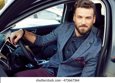 Portrait handsome elegant man in a car