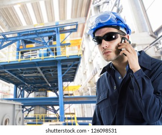 Portrait of an handsome engineer talking on the phone