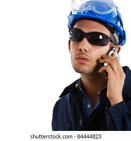 Portrait of an handsome engineer talking on the cell phone. Isolated on white