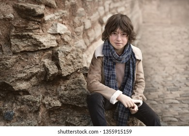 Portrait of a handsome and fashionable boy in autumn clothes.