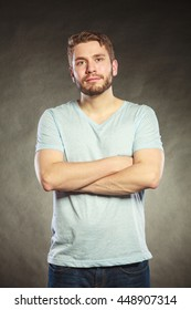 Portrait of handsome fashionable man in shirt. Young guy posing in studio on black. Casual fashion.