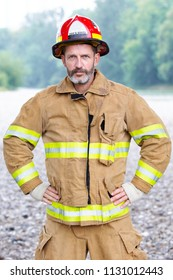 portrait of handsome fireman in uniform standing outdoors