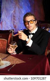 Portrait of a handsome groom on his wedding celebration.