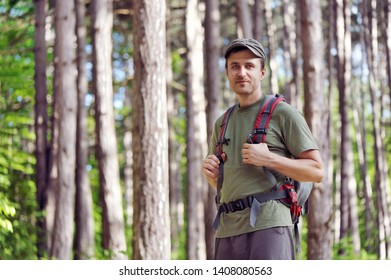 Portrait of a handsome hiker having journey in the forest area