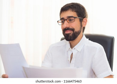 Portrait of a handsome hipster guy working at the office
