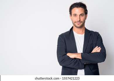 Portrait of handsome Hispanic businessman with arms crossed