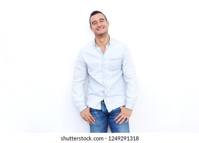 Portrait of handsome latin man posing against isolated white background