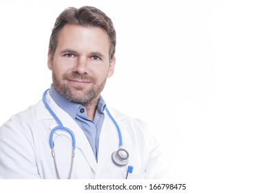 Portrait of handsome male bearded Caucasian doctor smiling wearing lab coat on white background with copy space