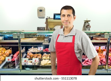 portrait of handsome male butcher with copyspace at the butchery