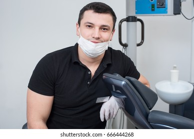 Portrait of handsome male dentist at the dental office. Dentistry
