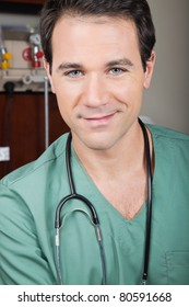 Portrait of handsome male surgeon smiling
