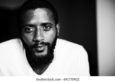 Portrait of handsome man with beard. Mixed race black skin, black and white photo