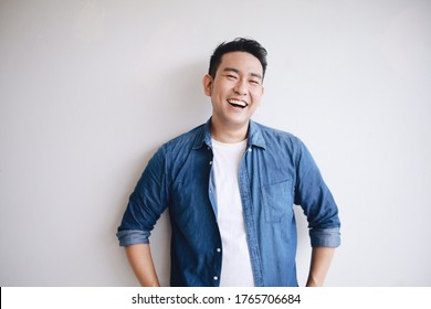 Portrait of handsome man in blue shirt with smiling face.