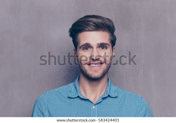 A portrait of handsome man in blue shirt looking at camera