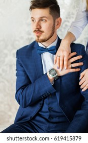 Portrait of a handsome man in a blue suit. Portrait of the groom. A man with a beard