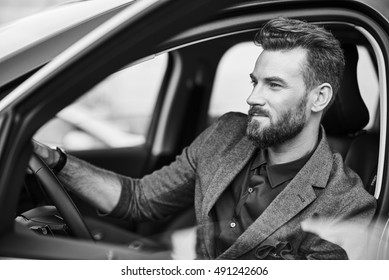 Portrait of handsome man in the car