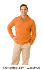 portrait of a handsome man casual dressed wearing khaki pants and an orange sweater smiling isolated on a white background
