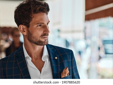 Portrait of handsome man in checked suit