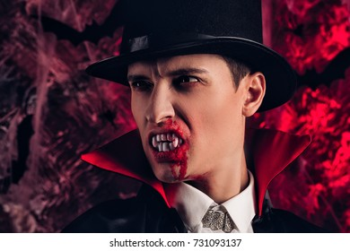 Portrait of handsome man dressed in a Dracula costume for Halloween. attractive vampire